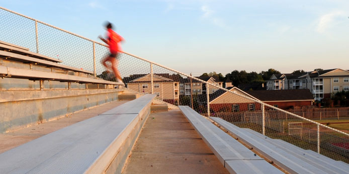 Switching form easy to hard workouts, like bleacher climbing, is key to increasing speed
